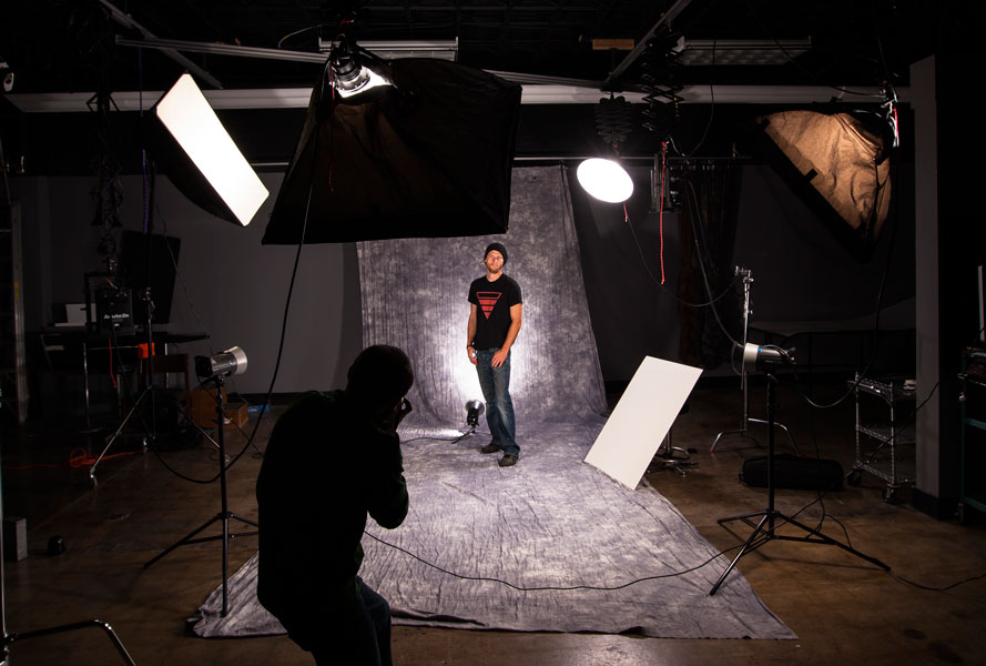 Student Anthony Petrone takes photos of Josh Larson for this semester's advanced studio/commercial photography class.