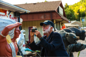 David Hume Kennerly takes a photo of a statue in Deadwood.