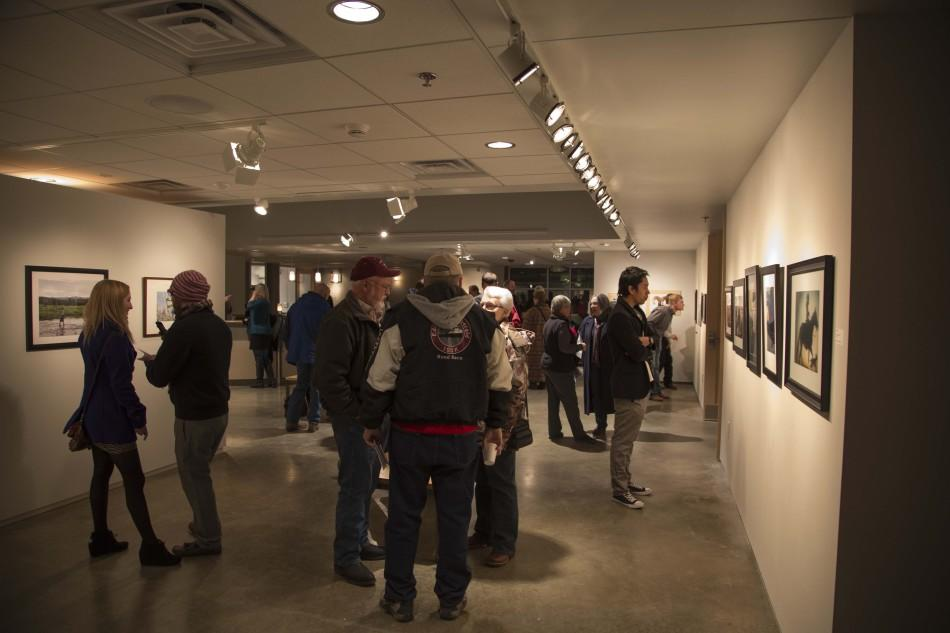 Group of People check out the submissions to the tenth annual Dahl Mountain Photo Exhibit on Feb. 7, at the Dahl Fine Arts Center in Rapid City.