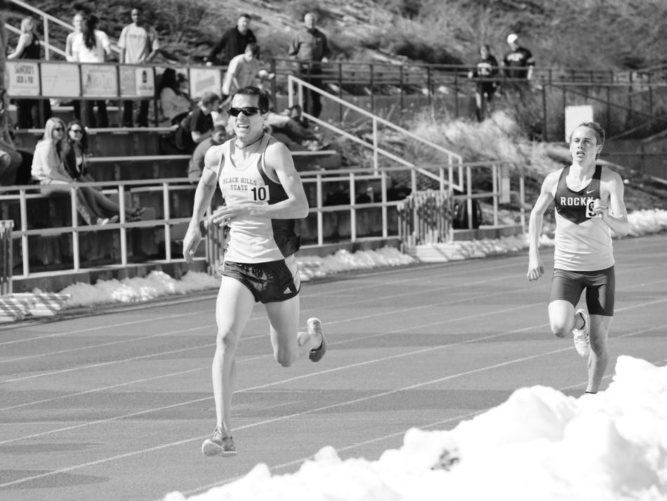 Mark Wilcox finishes the 1500 meter run in first place with a time of 4:06:00 during the Spring Open track meet, March 29, 2014, at Black Hills State University's Lyle Hare Stadium.