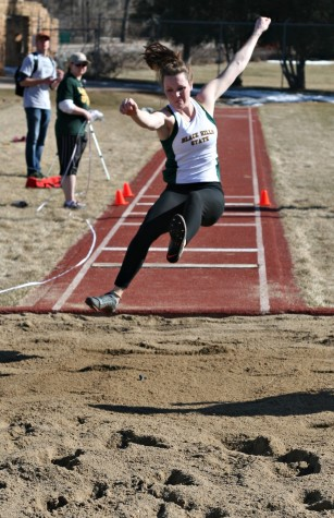 Paige Follet propels forward during the triple jump at the Yellow Jacket Spring Opening Track Meet. Follet won triple jump with 11.08 meters.