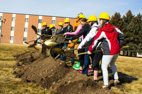 Students and administration take part in the groundbreaking for new residence hall.