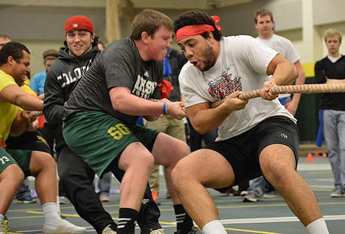 The Winona Cook hall men's tug-of-war team struggles against the opposing team at the All-Hall Battle in the Young Center.