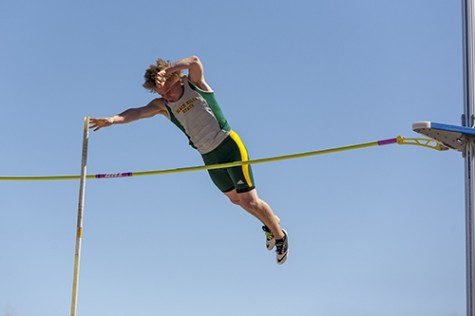 Ryan Mehalick clears the bar during the men's pole vault event.