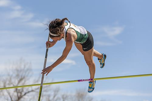 Courtney Cassen clears the bar during the women's pole vault event.