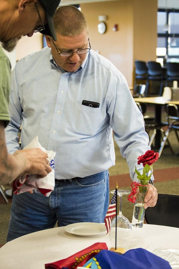 Veterans' Club members Steve Weir and James Hunt set up the Missing Man table in the Student Union Sept. 17 in observance of National POW/MIA Recognition Day. The table and its elements are put in place to honor and remember fallen, missing, or imprisoned military members