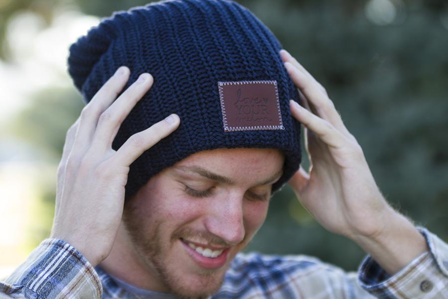Riley Winter puts on one of the beanies he purchased from LYM.