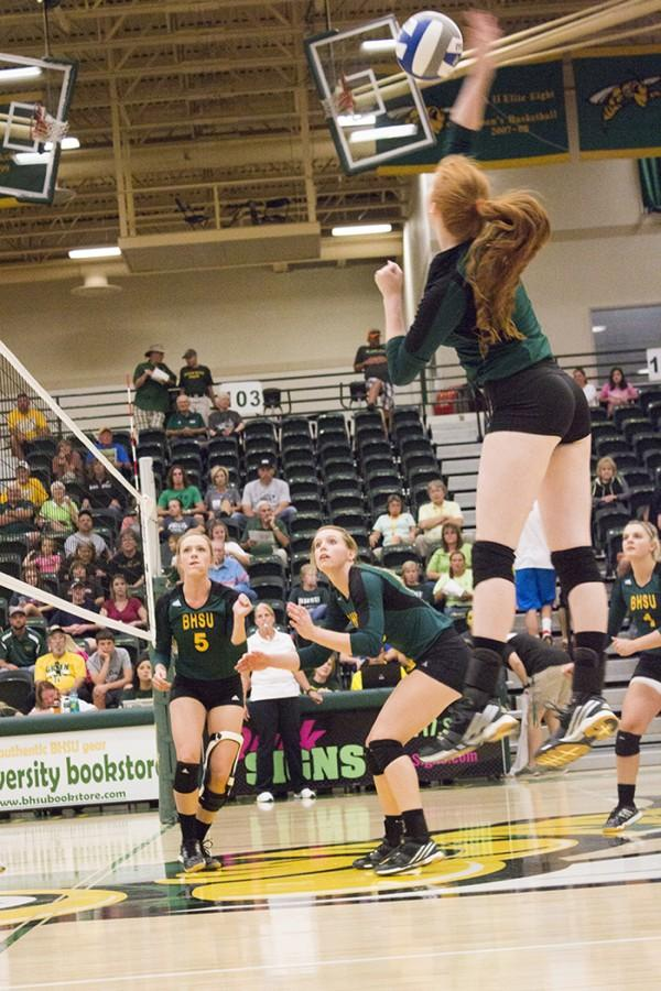 Kenzie+Kazmer+intercepts+the+ball+mid-air+in+the+volleyball+game+against+Western+New+Mexico+University+Sept.+26.