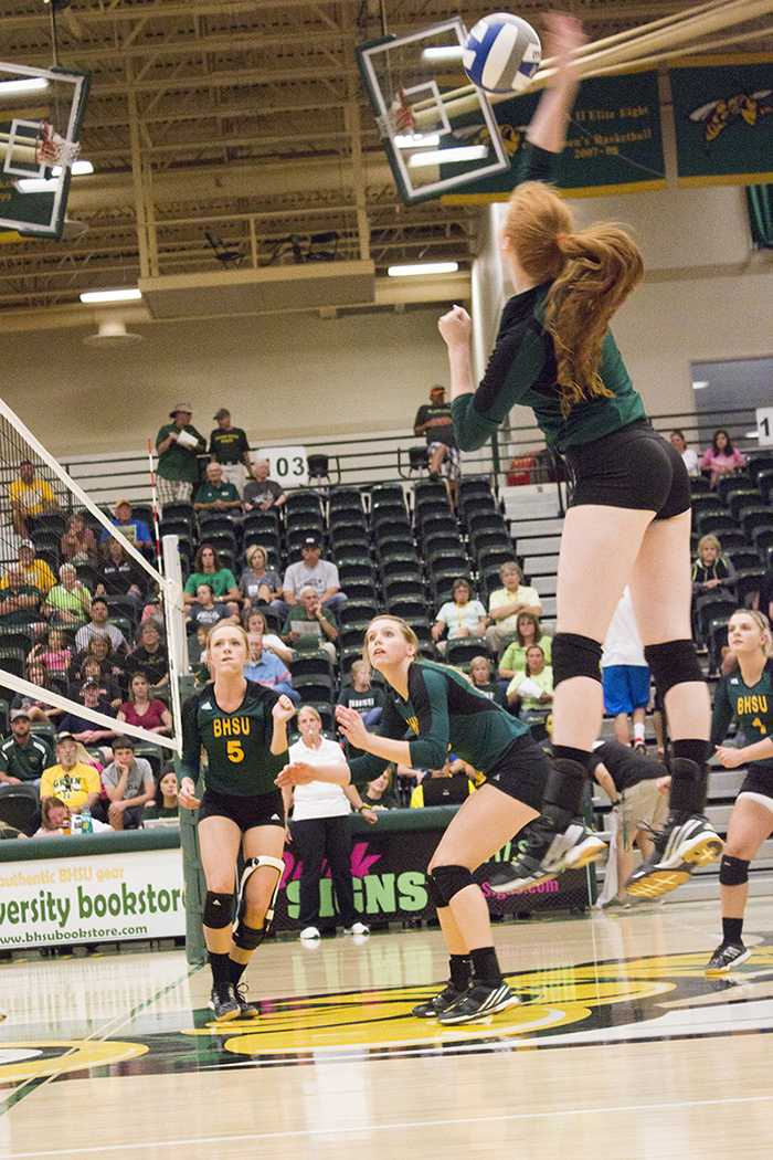Kenzie Kazmer intercepts the ball mid-air in the volleyball game against Western New Mexico University Sept. 26.