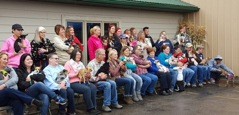 Chihuahuas and their new owners gather for a group picture at the Western Hills Humane Society second annual open house Oct. 3