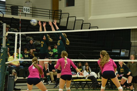 Brynn Eckhardt and Jessy Hibl jump up to block against Fort Lewis. The Yellow Jackets went on to win the series Oct. 23 at the Young Center.