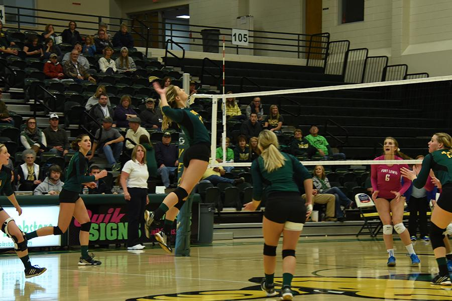 Ellise Lech spikes the volleyball against Fort Lewis. The Yellow Jackets went on to win the series Oct. 23 at the Young Center.