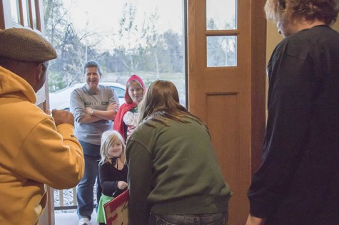 Black Hills State University Student Ambassadors Hannah Owens, Maddie Foster, Sam Hintgen and Sonja Pederson hand out candy and BHSU pencils at the President's house Oct. 31.