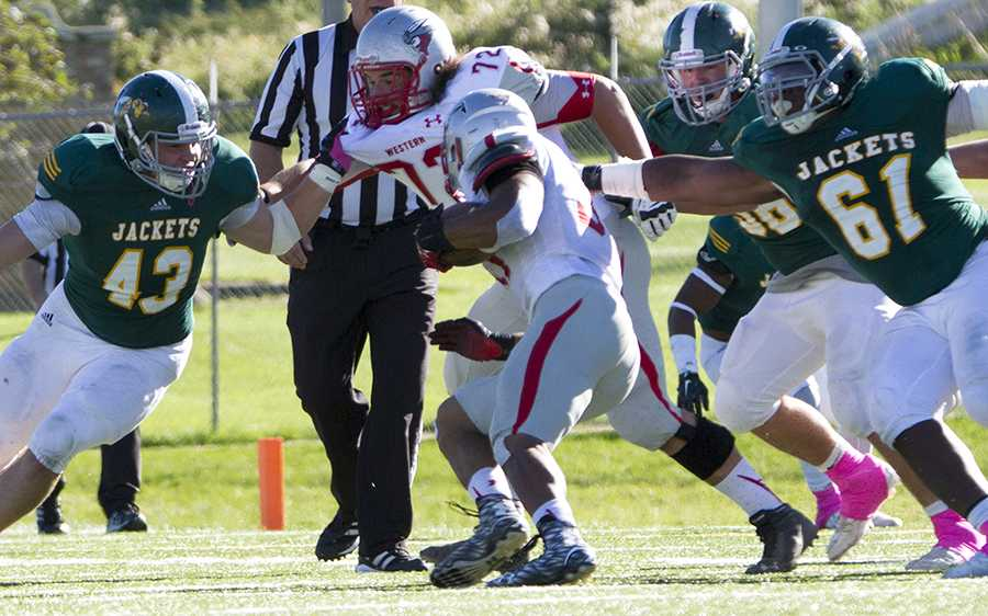 Thayer Sauter (43) and Lorenzo Tanner attempt to take down Western State Colorado during Swarm Week's Oct. 10 game.