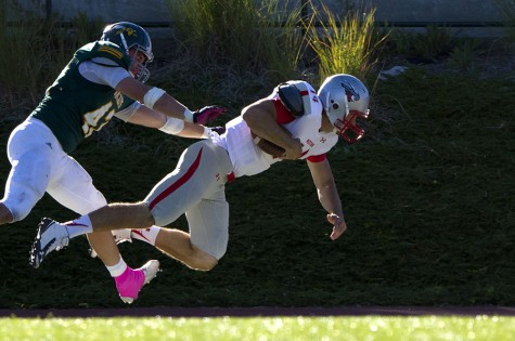 Thayer Sauter takes down Western State Colorado's Cameron Shumway during Swarm Week's Oct. 10 game.