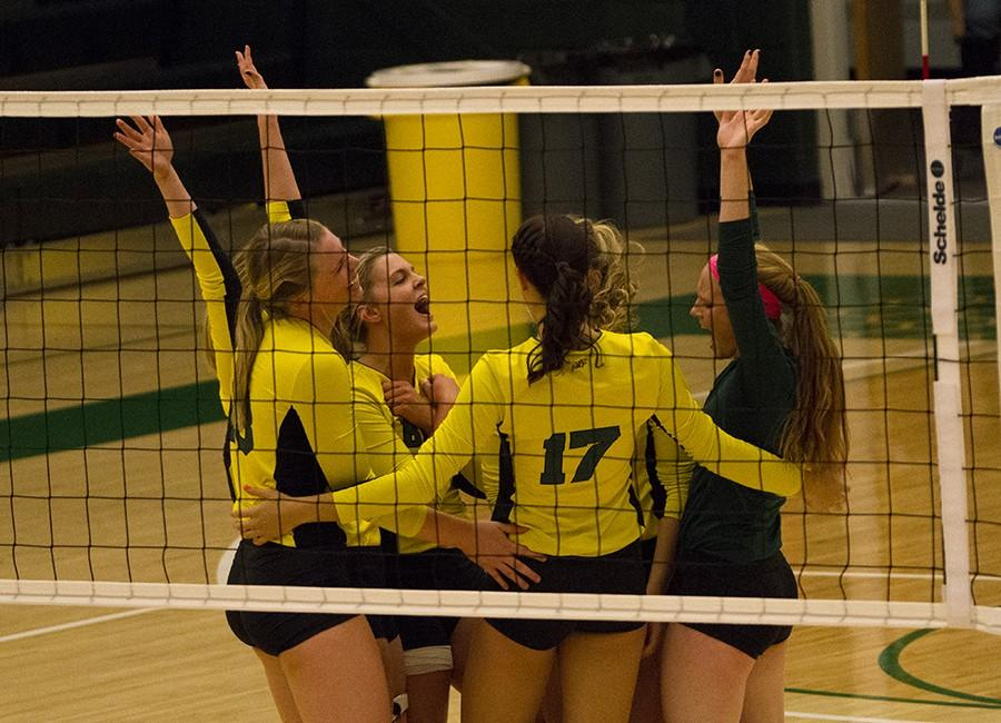 The team cheers after it scores a point against Regis during Swarm Week's Oct. 10 game.