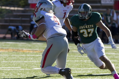 Safety Travis Groves goes after Western State Colorado's Zach Griggs during Swarm Week's Oct. 10 game.