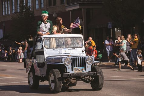Black Hills State University Homecoming King Jordan Thaler and Queen Sonja Pederson wave to the crowd during the 2016 Swarm Days parade Oct. 1.