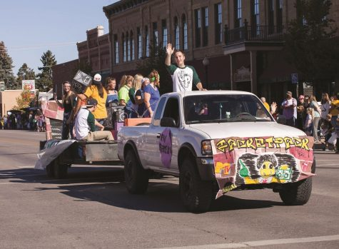 Levi Kessler of Black Hills State University Jacket Pack waves to the crowd during the 2016 Swarm Days parade Oct. 1.