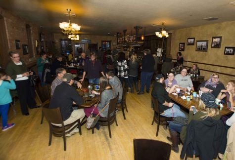 Community members, college students, and professors gather for the annual Empty Bowls fundraiser and silent auction Oct. 19 at the Deadwood Social Club.