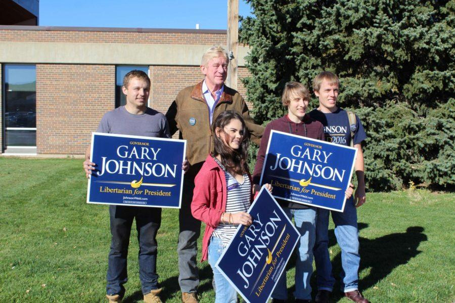 Black Hills State University Students stop to take pictures with Governor Bill Weld in front of the Jonas Science building before his speech in Club Buzz Oct. 20.