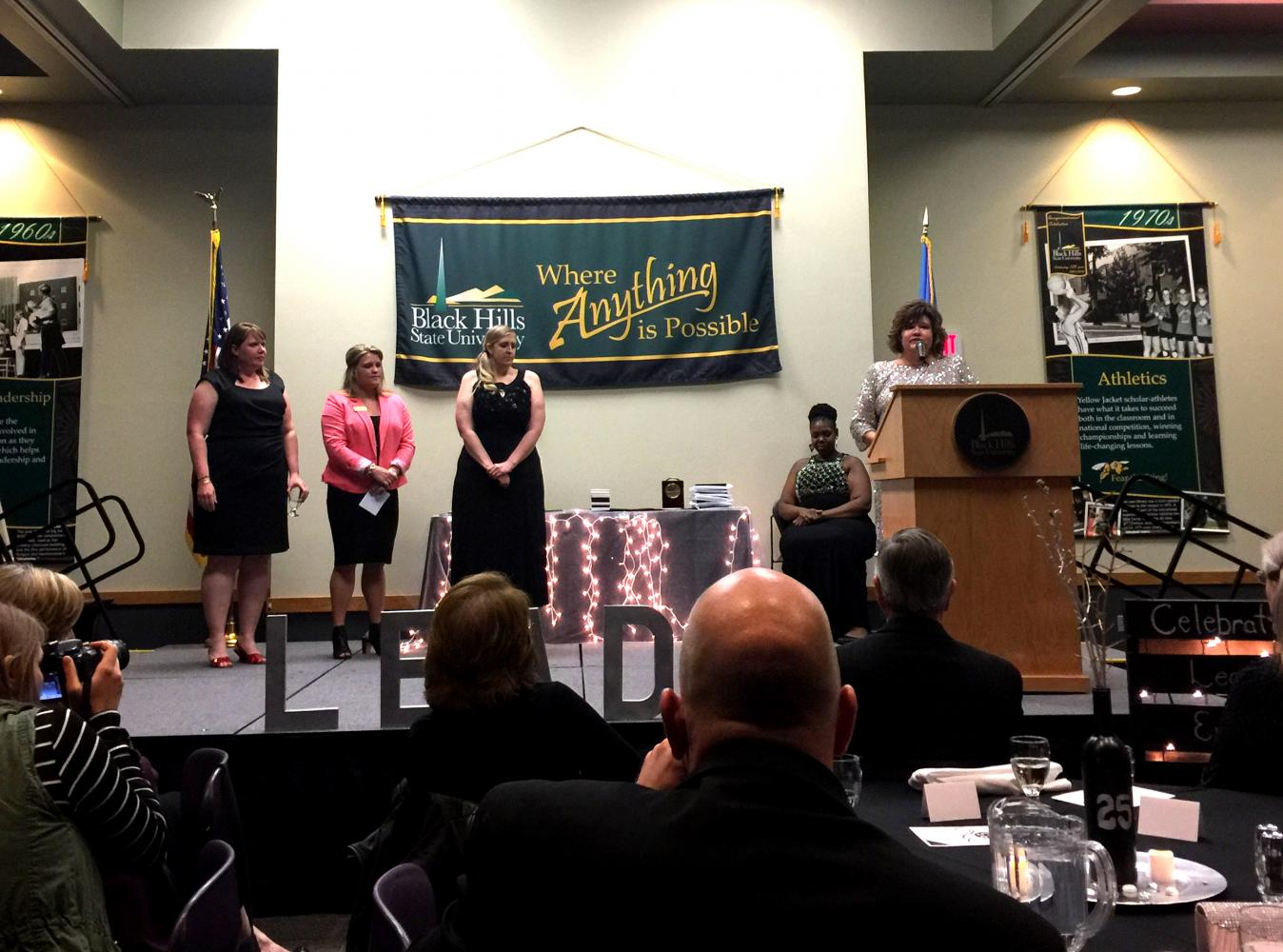 Dr. Jane Klug addresses the audience after several student testimonies from alumni Megan VonHaden, Lorrin Naasz and student Jessie Gramm about Jane's impact in students' lives.