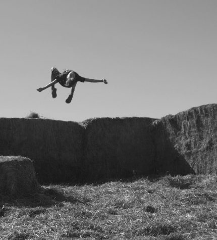 Amazing kid does a back-flip high in the air, while jumping off the hay bale stack. Spearfish Corn Maze and Pumpkin Patch.