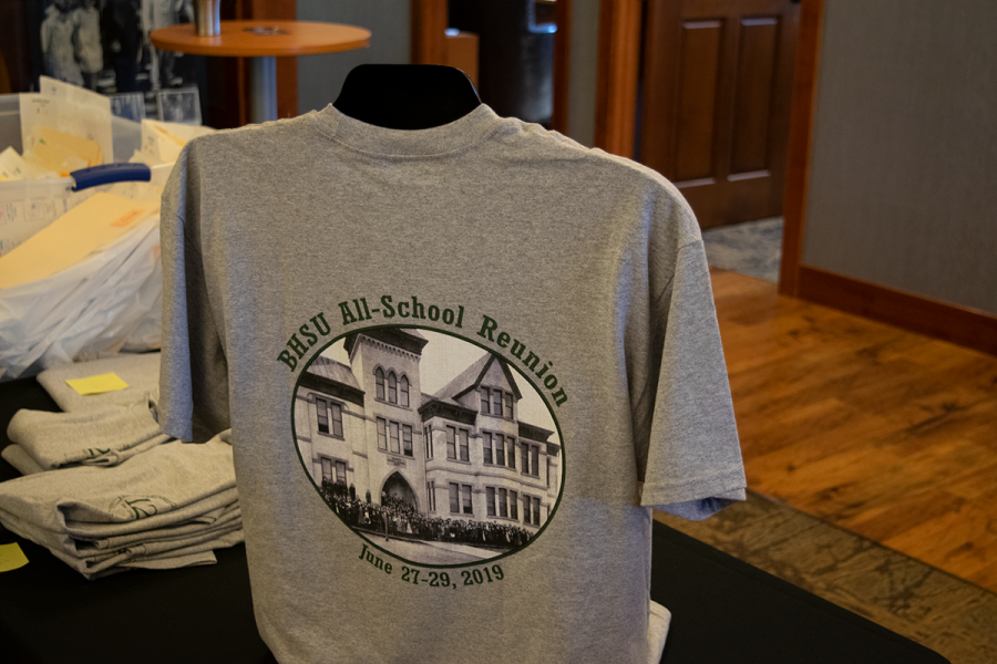 A commemorative T-shirt is set on display at the Joy Center. Merchandise and souvenirs were available for purchase at the breakfast receptions.