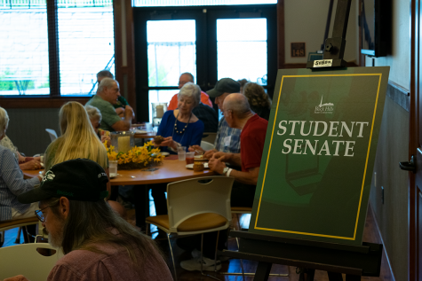 Alumni follow the signs to their breakfast seating. The Student Senate reception was held on Friday, June 28, 2019.