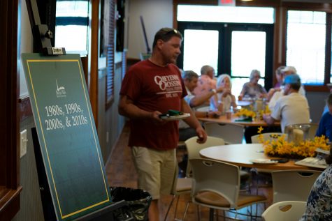 A guest returns to his seat at the Saturday breakfast reception. Breakfasts were held at the Joy Center on both Friday, June 28, and Saturday, June 29, as part of the All-School Reunion.