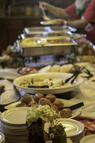 Guests dish up at the reception. Both morning receptions featured a catered breakfast.