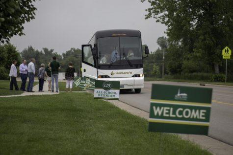 Alumni board a chartered bus for a guided tour. The bus tour was one of the events organized for the three day reunion.