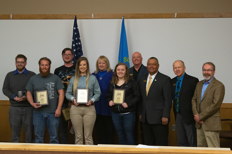 Presenters and recipients at the 2019 Student Recognition Awards display their awards. From left to right: Brandyn Johnson, Terry Irvine, Dennis Morton, Dreena Streckfuss, Julie Scott, Brynne Dilley, Charles Knauer, Tom Jackson, Jr., Gene Bilodeau, Greg Farley.