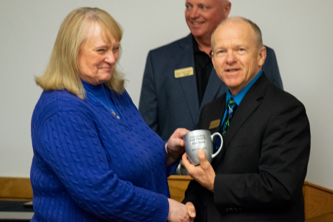 BHSU-Rapid City Executive Director Gene Bilodeau presents Julie Scott with the award for Outstanding Staff. Scott