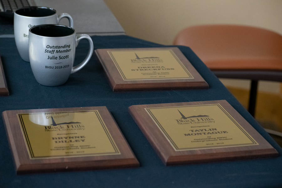 Award plaques are arranged on display before the Student Recognition Awards ceremony. Awards were presented to both BHSU and SDSU students.