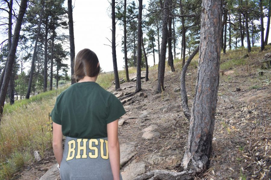 Freshman, Anita Akers, enjoys the nice weekend weather in Rapid City with a hike up M Hill.