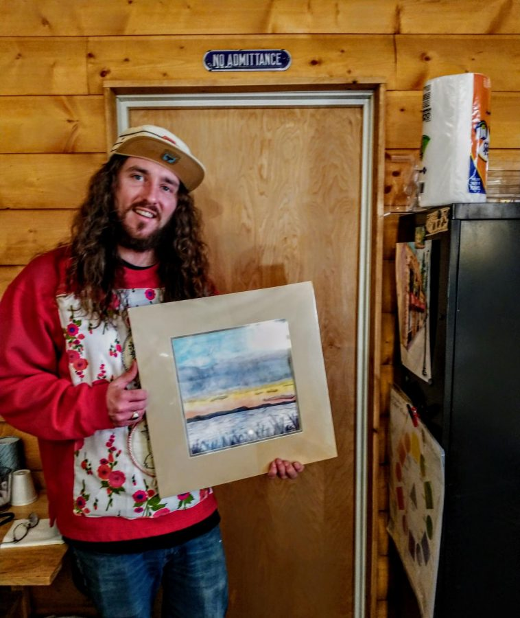 BHSU alumni Drew Dutton proudly displays his art piece in the gallery room of Artifacts, Antiques and Art, located in Spearfish, S.D.